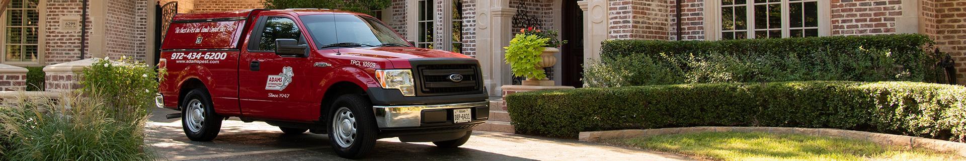 adams pest control's truck in grapevine tx