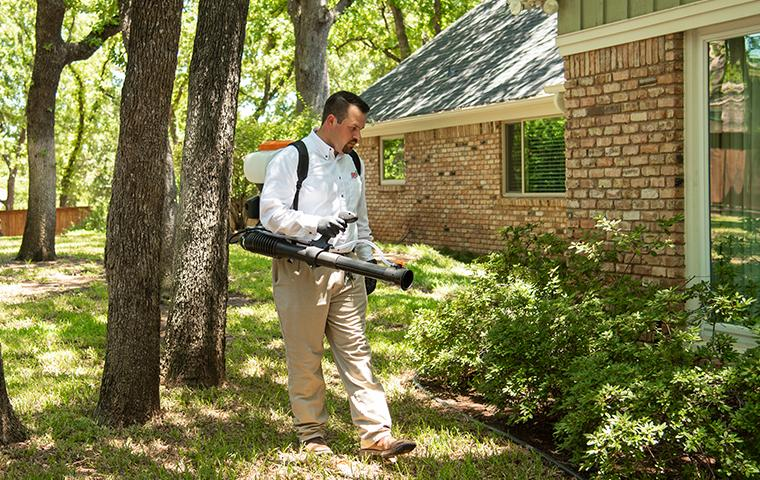 tech backpack misting around property in denton texas