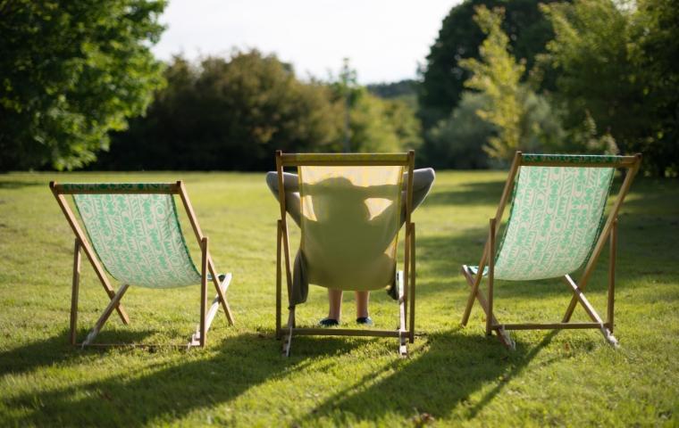woman relaxing in a lawn chair in backyard