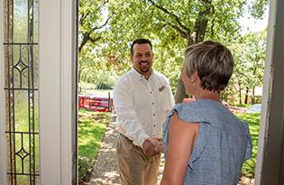 technician greeting homeowner
