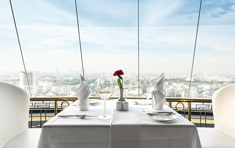 white themed restaurant table with city view