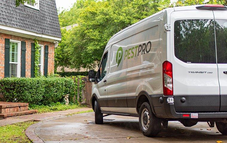 a pest pro company van in driveway