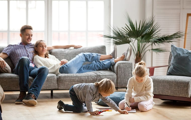 a family and dog inside of an apartment room serviced by thermalrid in nashville tennessee