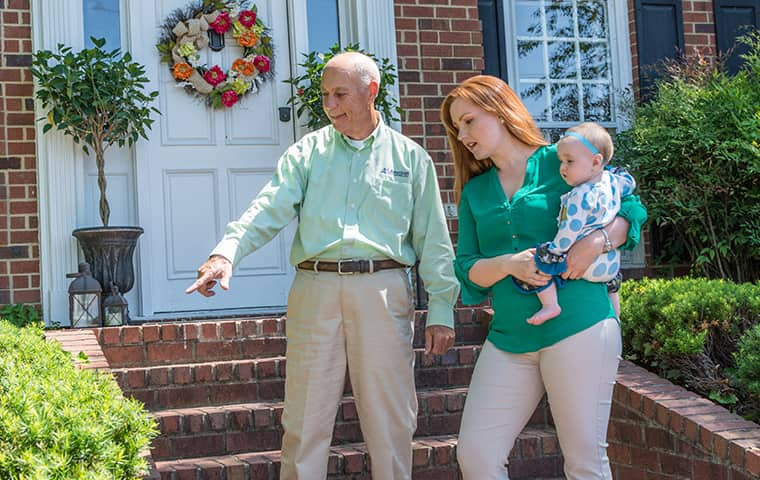 all american tech explaining services to a client outside of her murfreesboro tennessee home