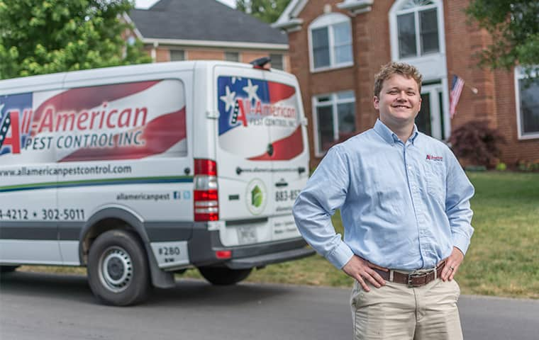all american tech standing in front of service vehicle outside of nashville tennessee home