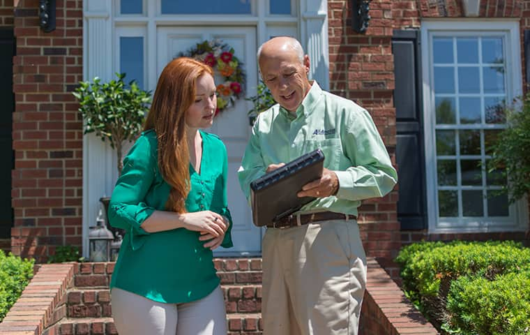 all american tech explaining services to a client outside of her oak hill tennessee home