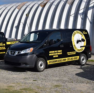 a four seasons hometown pest control company vehicle parked outside in outerbanks north carolina