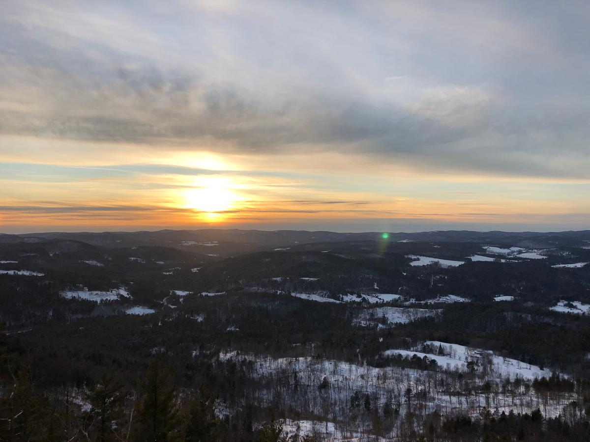 A golden and blue sunset spreads over the valley in a view from Wright's Mountain.