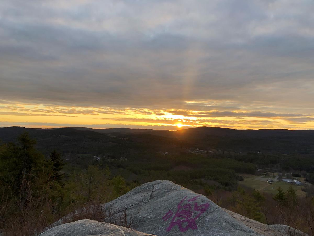 The sun peeks over the horizon in the view from French's Ledges