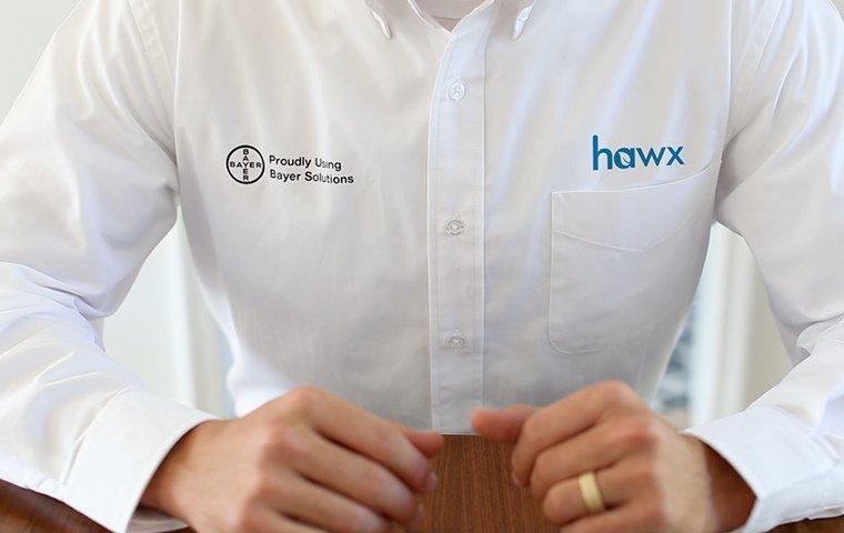 a hawx pest control service technician