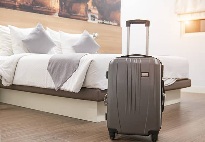 suitcase in a hotel room that could potentially have bed bugs in it