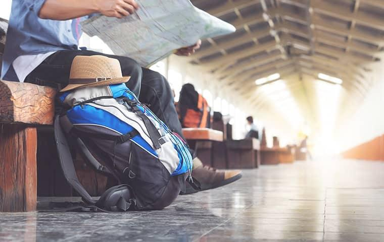 man traveling sitting in airport