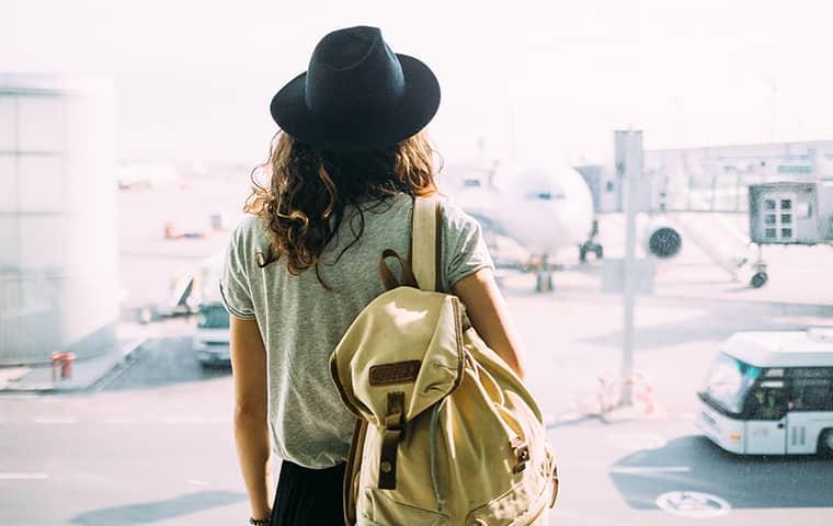 girl leaving airport for spring break