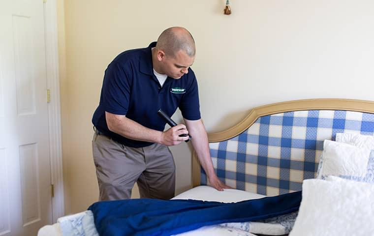 parkway tech does a bed bug inspection during the holiday season