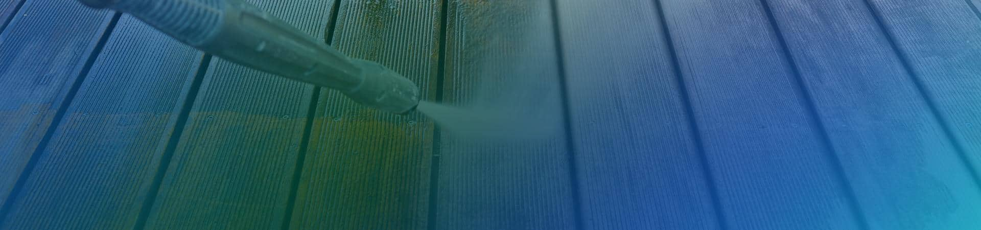 a power washer spraying a deck in new york