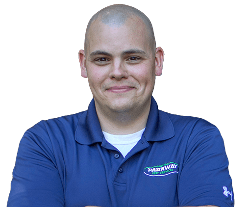 a pest control technician smiling