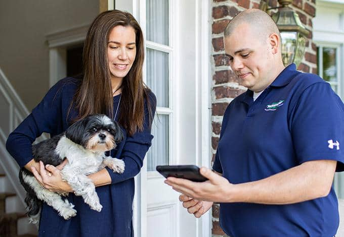 residential pest control expert with customer