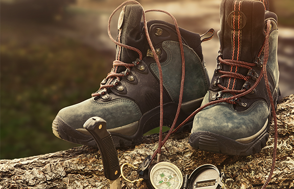 hiking boots knife and compass