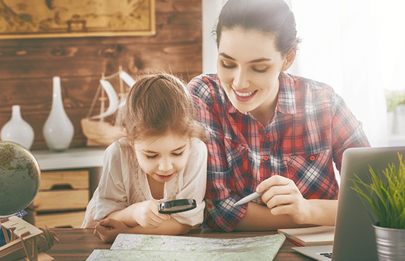 mother and daughter looking at maine map