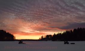 sunrise atv ice fishing orange clouds