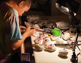 talia painting flags on rocks