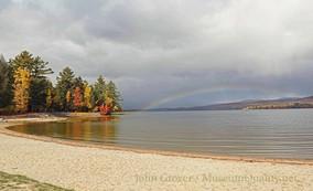 fall rainbow over water 1