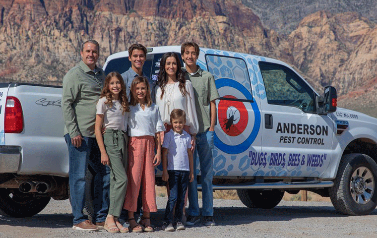 the anderson family in front of the anderson pest control truck