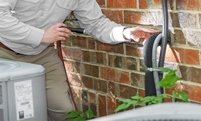 technician inspecting exterior