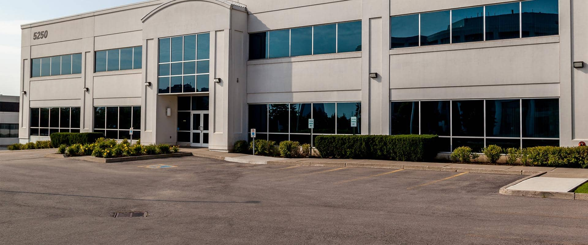 modern office complex with professional shrubs and landscaping in modesto california