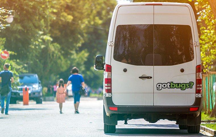 gotbugs company vehicle parked outside home
