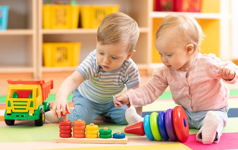 two small children playing at a daycare