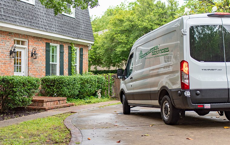 a company vehicle in the driveway of a nice brick home in brick new jersey