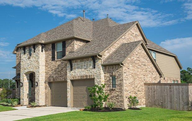 street view of a home and lawn in conroe texas