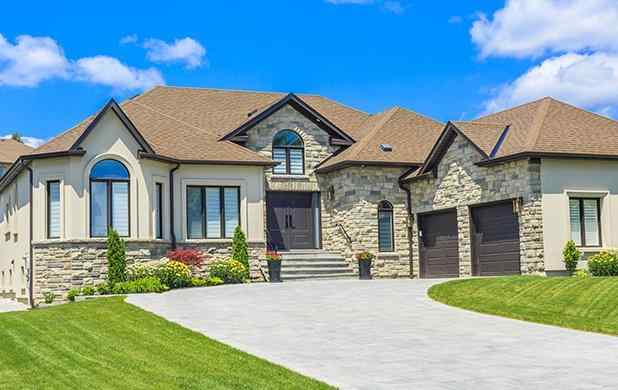 view from the driveway of a large suburban home in frisco texas