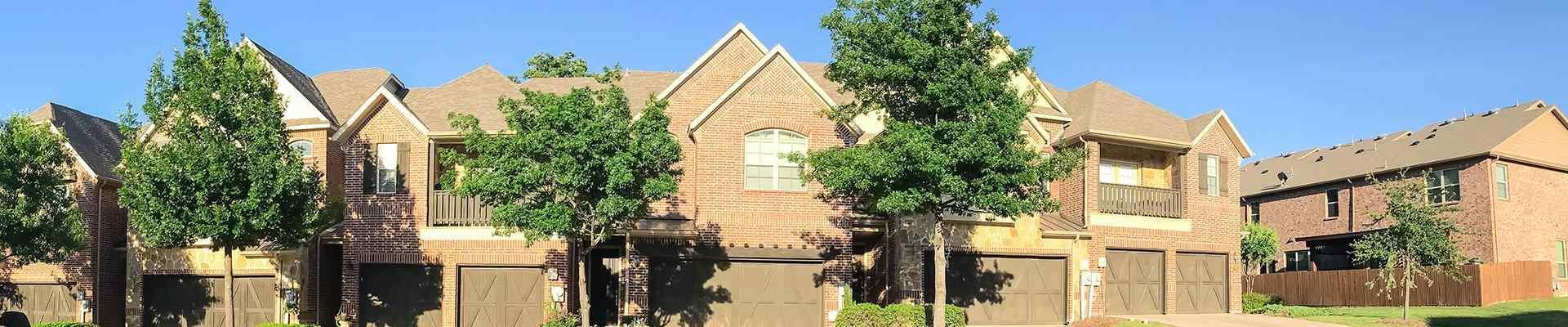 a row of homes in a suburban neighborhood in allen texas