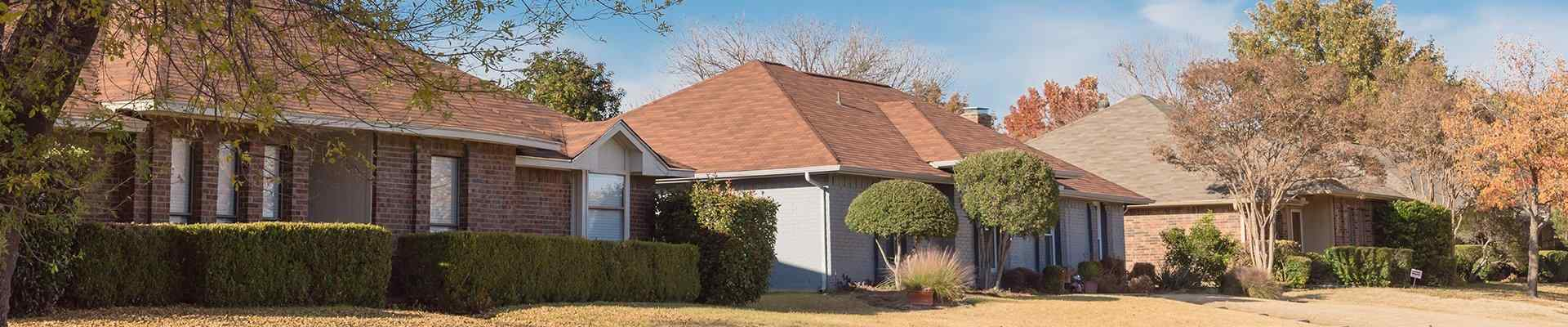 a row of homes in a suburban neighborhood in argyle texas