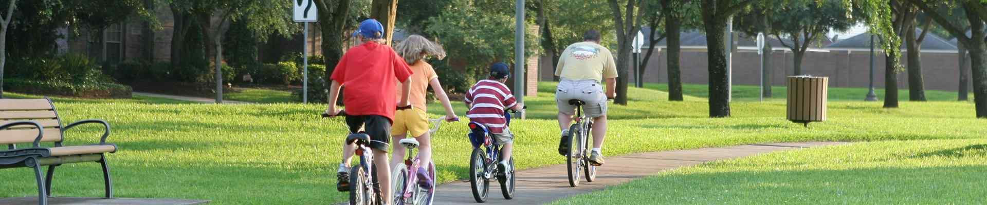 a family on bikes in a park in bedford texas