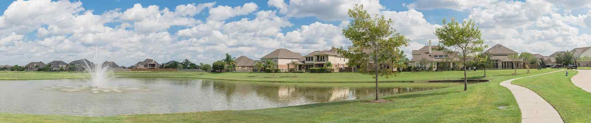 a view of a fountain and homes in fairview texas
