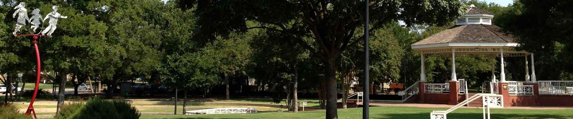 a view of a park and gazebo in plano texas