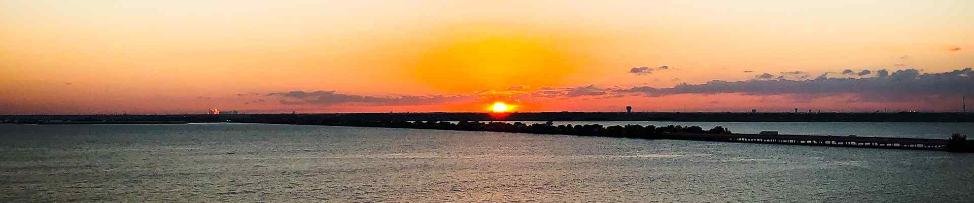a sunset over the water in rockwall texas