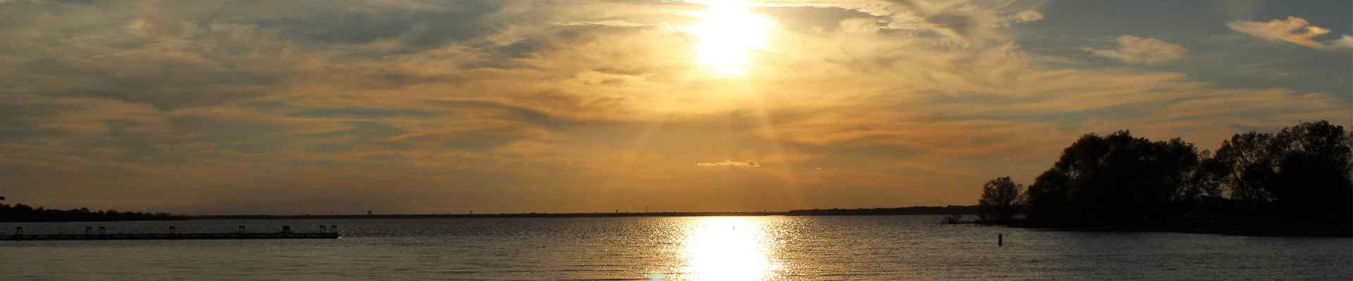 sunset over a body of water in shady shores texas