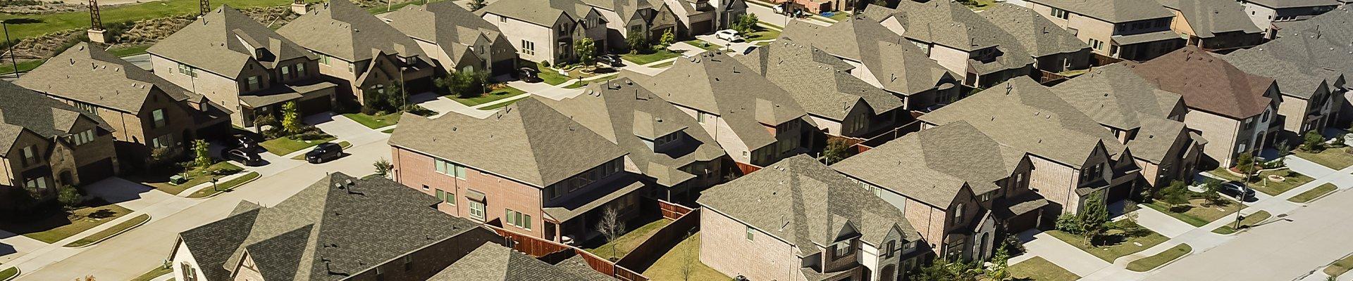 a row of homes in a suburban neighborhood in spring texas