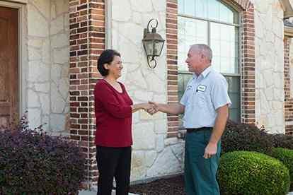 pest control tech greeting homeowner