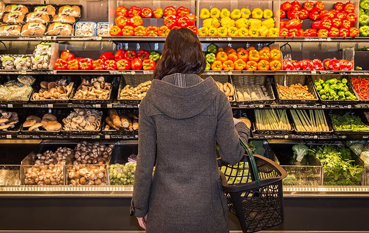 woman standing in grocery store
