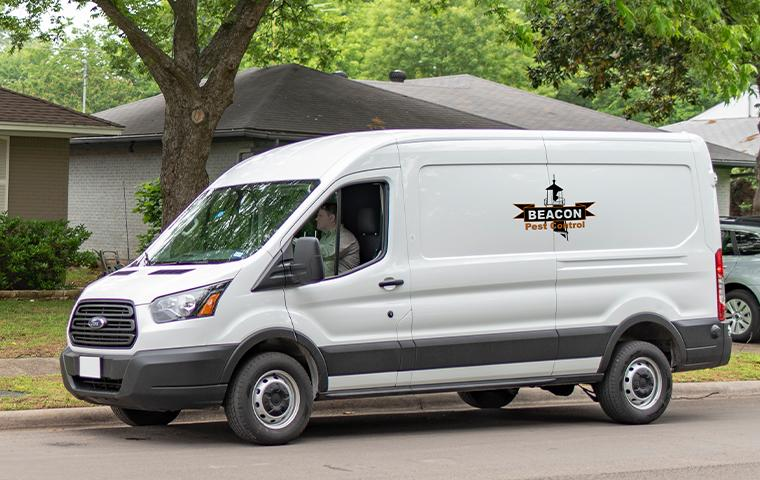 company van pulling up to house