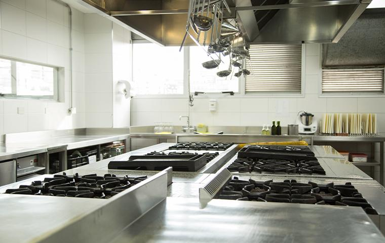 commercial kitchen with gas range stoves