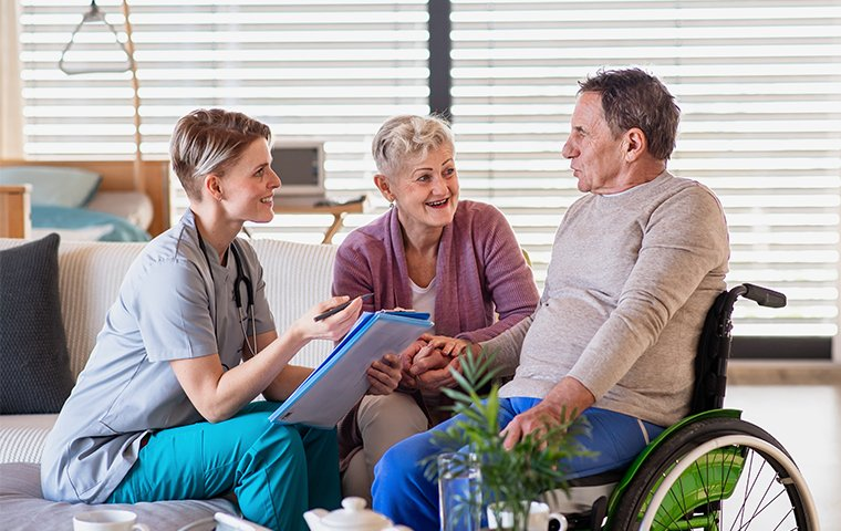 a healthcare working talking to a senior man