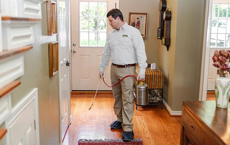 a pest control service technician inside of a home in manhattan new york
