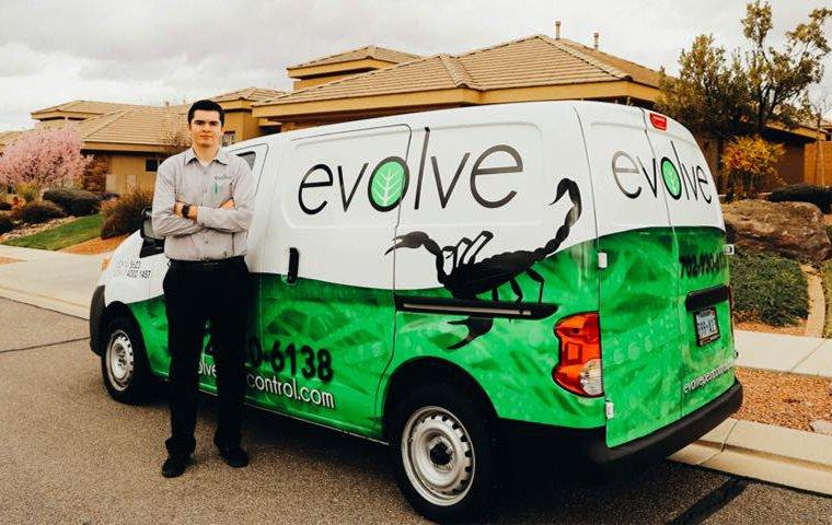 a pest technician standing beside his service vehicle in dallas texas