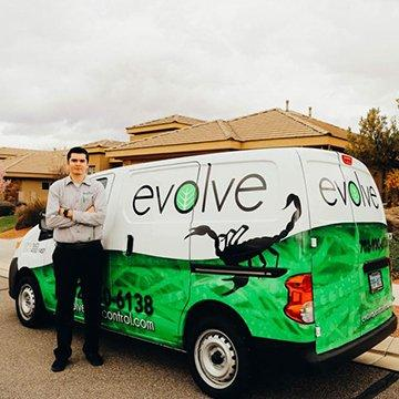 evolve pest control company van in front of commercial building in fort worth texas